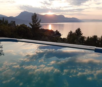 Photo for A modern villa in a unique setting with stunning views. The real Greece.