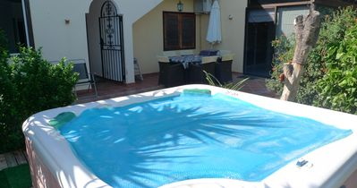 Photo for 5 Bed Villa with Free Wifi, 6 Seater Hot Tub & Spectacular Sea & Golf views.