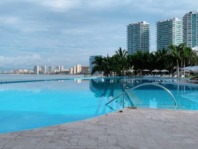 Photo for PENINSULA Condo.  Beach front, gorgeous view, 3,300 sq ft 4 BR CORNER Unit.
