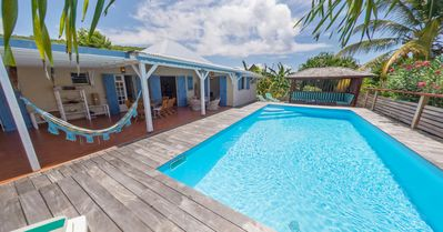 Photo for House exposed to alizé winds with 4 bedrooms and private swimming pool in closed tropical garden