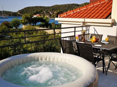 Photo for Penthouse apartment with teracce jacuzzi and sea view,10m from sea,free parking