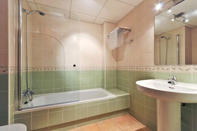 Both bathrooms have a shower over the bath