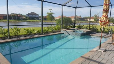 Photo for Brand new 4/3 single family home with private pool, hot tub & lake view