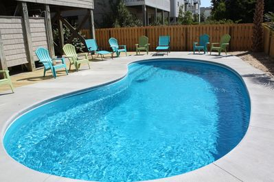 Large fenced private pool w spacious deck area including covered/shady spaces