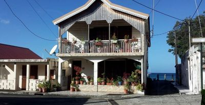 Photo for duplex, 2 bedrooms, 2 couples overlooking the sea overlooking the village of DESHAIES