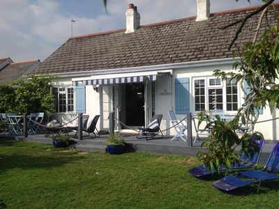 Photo for Detached Sunny Seaside Cottage With Private Garden Surrounding And Sun Deck