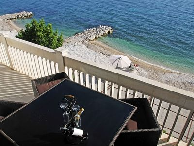 Photo for Luxurious Beach front apt. with private: beach, parking, BBQ, magnificent views.