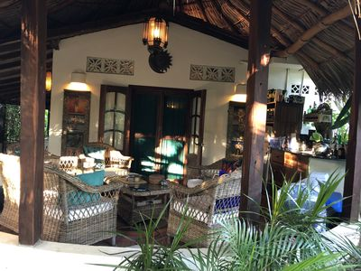 The Frida's palapa covered patio with lounge and kitchette
