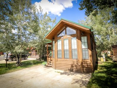 Photo for Totally immerse yourself in the mountains - 1 bed/1 bath with mountain decor, cozy living area, fully furnished kitchen, and covered private side patio perfect for morning coffee