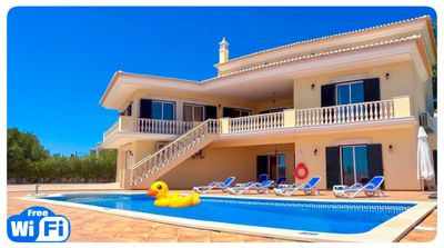 Photo for Large modern villa with pool & elevated views to the sea.