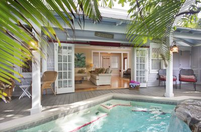 French doors lead into the living room - Private pool area leads directly to living room through traditional French doors...