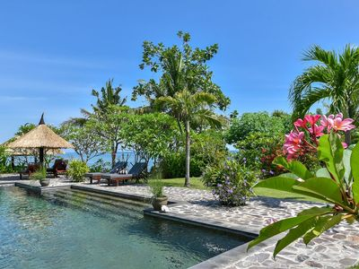 Photo for 5 * Seafront pool villa 'Bagus' 4 br. private tropical garden, cook & coral reef