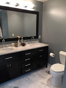 Master Bedroom ensuite bathroom with his and her dual sinks.
