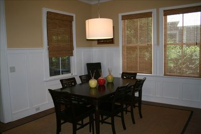 Dining room with additional seating at kitchen counter or screened porch