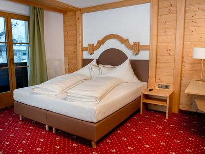 Photo for Double room with balcony - Alpenresort Walsertal - The 4 star hotel 'At the top'