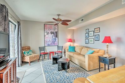 Admire the artwork hung on the living room walls of this condo.