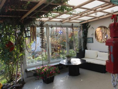 Photo for Apartment in garden paradise with fireplace and gazebo