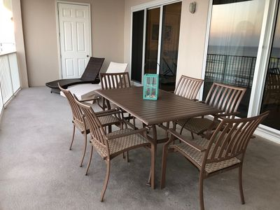 Check out this HUGE 300 sq. ft. balcony! There's seating for 6, in addition to 2 more chaise lounges!!