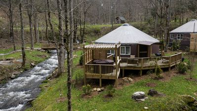 Photo for GLAMPING AT ITS FINEST! CREEKSIDE LUXURY YURT with Fire Pit, Hot Tub and Grill