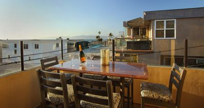 Enjoy ocean breezes, the warm sun on your face, and  ocean views on  the deck