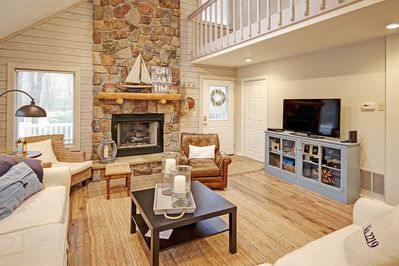 great room with gas fireplace, sliding doors to deck