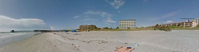 Panoramic view of Cocoa Beach Towers and the Cocoa Beach Pier