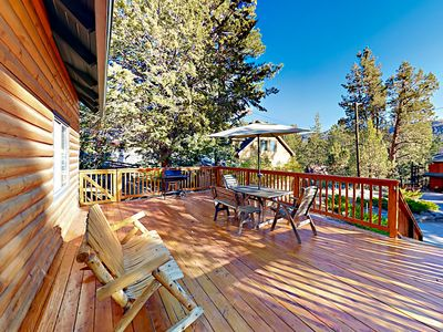 Deck - Lined with a gated railing, the front deck boasts abundant outdoor entertaining space.