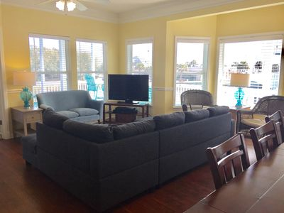 A living room with plenty of seating.