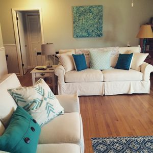 Beautiful new slipcover couches in living room.