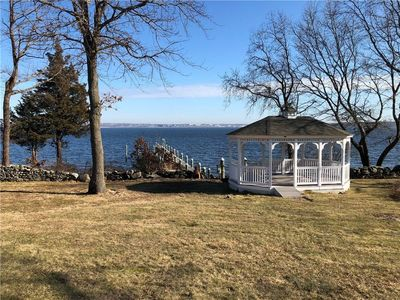 Photo for This waterfront property is located on Narragansett Bay overlooking Newport.