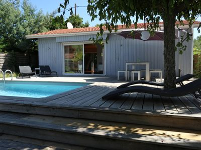 Photo for Pleasant wooden house with character, design decoration and swimming pool