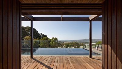 Bay views overlooking the infinity edge pool and vines