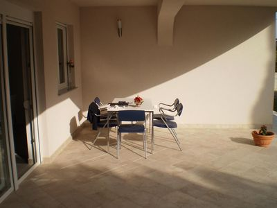 Photo for Two bedroom apartment with terrace and sea view Banjol, Rab (A-12838-a)
