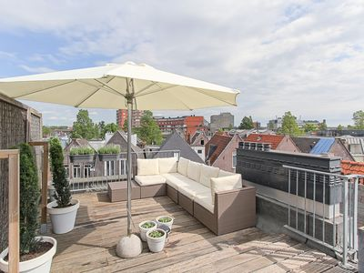 Photo for Comfortable apartment in vibrant the Pijp with sunny private roof terrace