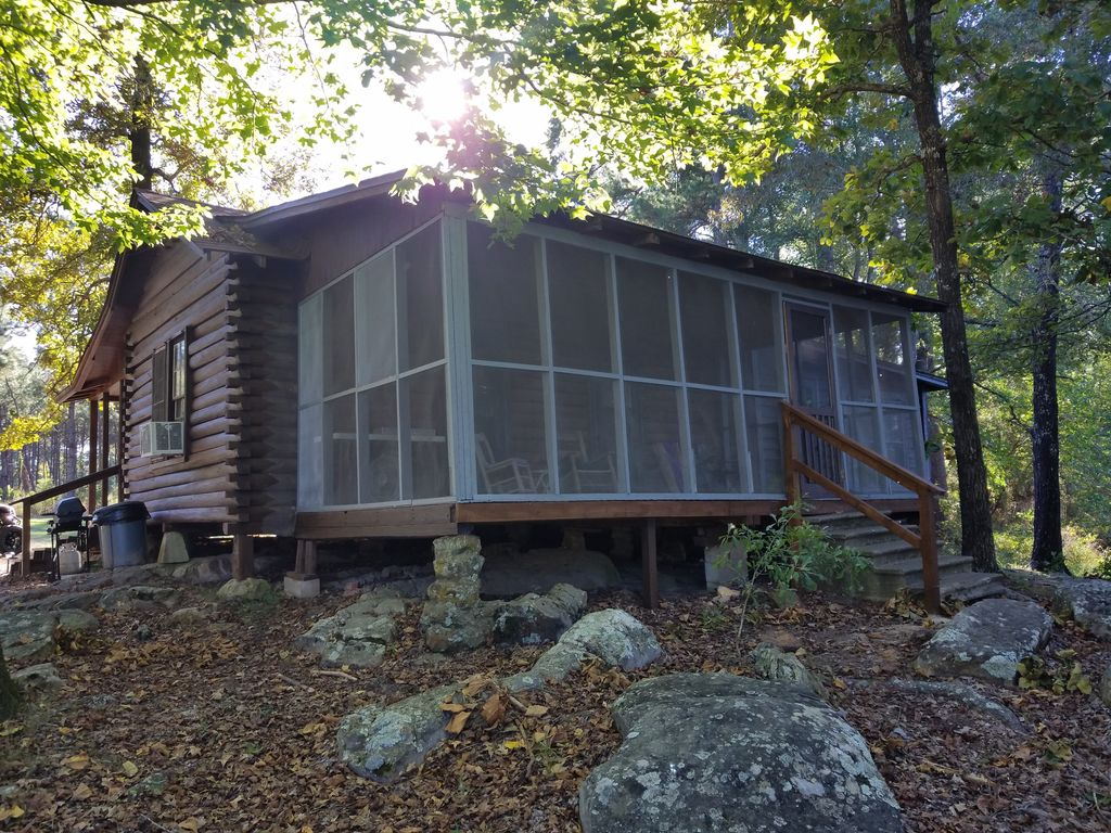 Secluded 1930 39 s log cabin on east texas private fishing for Fish lake cabins