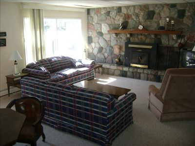 Family Room with wood burning fireplace. Games table for fun.