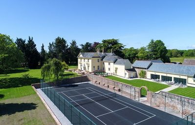 Tennis court, indoor pool, hot tub and large gardens