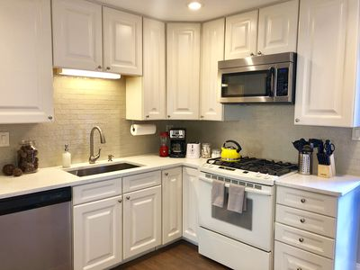 Fully equipped kitchen with plenty of pots/pans and cookware.