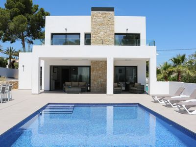 Photo for Modern brand new villa, 5 bedrooms, pool, sea views, 400 m from Cala Baladrar