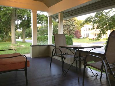 View from front door features spacious porch and built in bench.