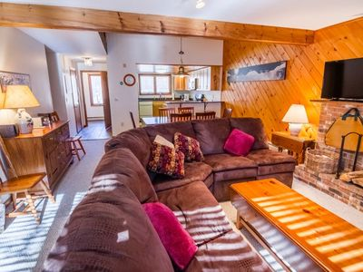 Photo for Relax and enjoy this great town house at Glazebrook located a very short distance from the Ramshead base lodge parking lot.  A wood burning fire in this fabulous living room is the great way to end the day.
