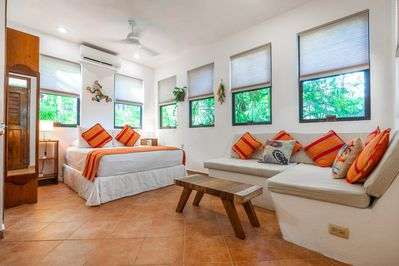 A light filled ground floor studio with blinds,  fans, and air conditioning