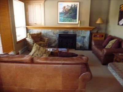 Comfortable living room and view to golf course and mountains