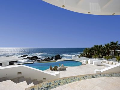 The backyard pool area and Ocean.