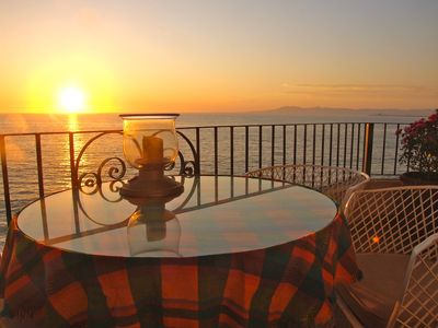 The balcony is the perfect spot to have cocktails or dine and enjoy the sunset