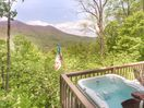 Enjoy the hot tub while taking in the view