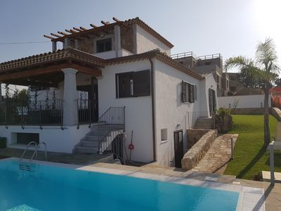 Photo for Semi-detached house with private pool in the most beautiful location of Budoni