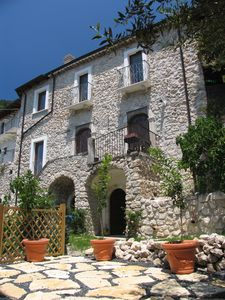Photo for Beautiful stone house, high in the medieval mountain village of Roccacasale