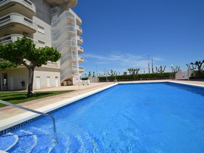 Photo for Air conditioned apt. with pkg, Wifi & sw. pools, 280m from the beach - La Pineda