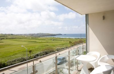 Photo for Wonderful views over Newquay Golf Course and Fistral Beach. Allocated underground car space